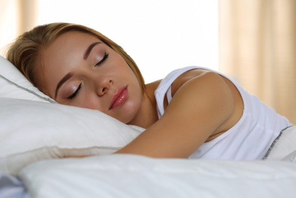 Image of a girl sleeping on pillow