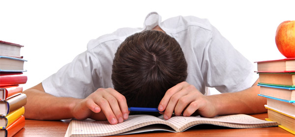 Image of a lad asleep on a desk